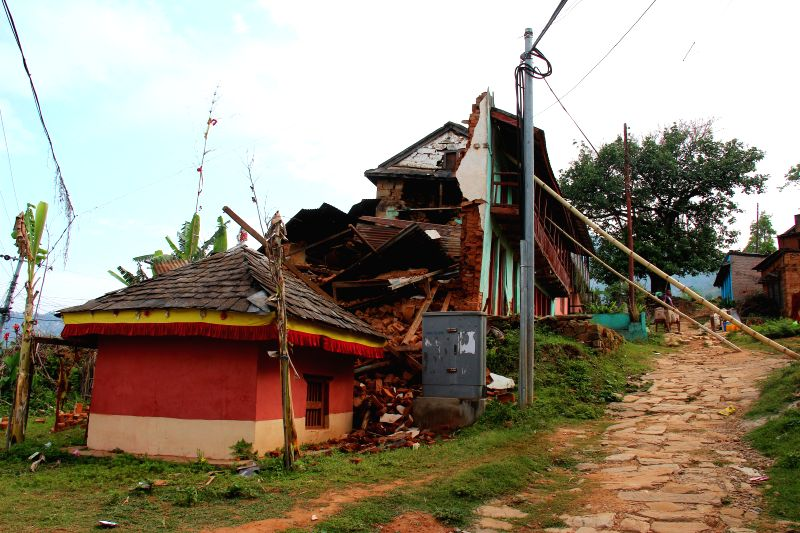The photo taken on April 28, 2015 shows a collapsed house in Gorkha, Nepal, where the epicenter of Saturday's massive earthquake is located. The death toll from ...