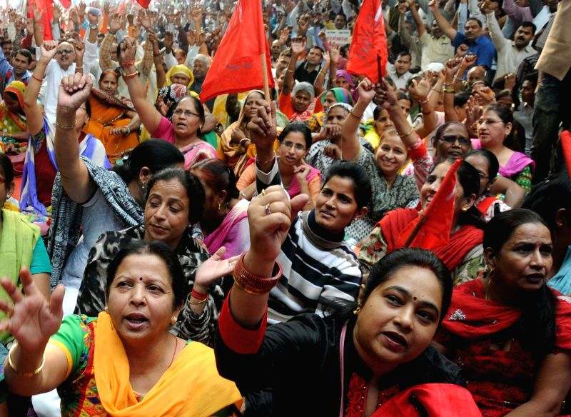 Government employees  stage a demonstration against anti-labour policies of the central government at Jantar Mantar in New Delhi on Nov 19, 2015.