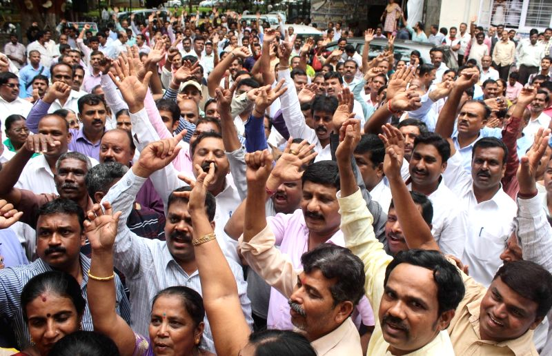 Government employees stage a demonstration to press for various demands during a day long strike called by them, in Bengaluru on June 2, 2016.