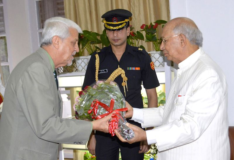 Governor of Goa Bharat Vir Wanchoo with Governor of Karnataka H.R Bharadwaj at Raj Bhawan in Bangalore on April 20, 2014.