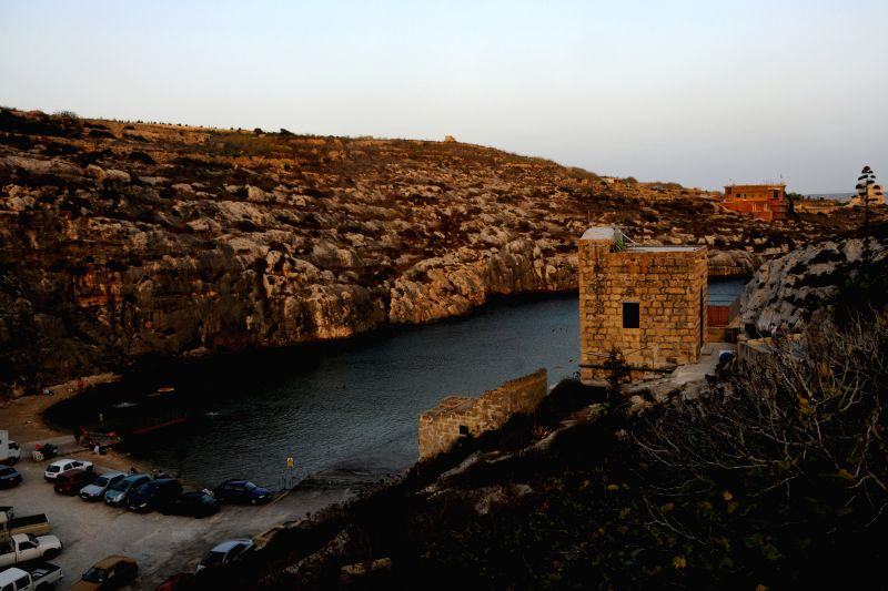Photo taken on Aug. 17, 2014 shows the view of Mgarr ix-Xini beach in Gozo, Malta. Brad Pitt and Angelina Jolie will start their new movie called By the Sea on Monday ..