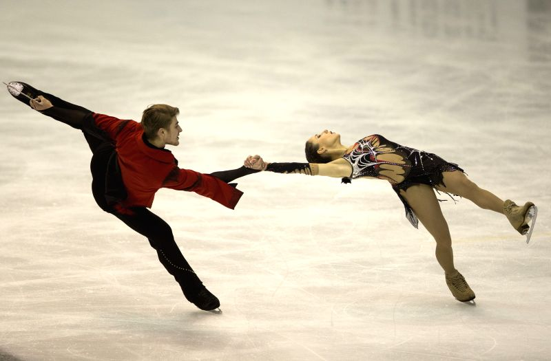 Kristina Astakhova (R) and Alexei Rogonov of Russia perform during the final of pairs free skating at the 27th World Winter Universiade in Granada, Spain, Feb. 7, ..