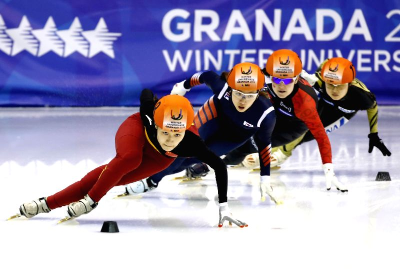 Li Hongshuang of China (Front) competes during the ladies' 3,000m short track relay event at the 27th World Winter Universiade in Granada, Spain, Feb. 13, 2015. ...
