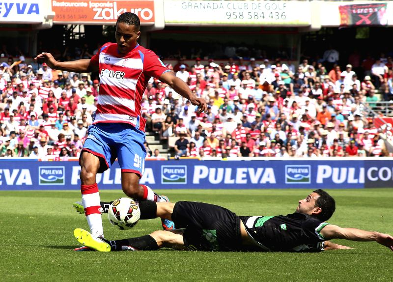 Granada's Youssef El Arabi (L) in action against a Cordoba's player during their Spanish Primera Division league's match at Los Carmenes stadium, in Granada, southern Spain, 09 May 2015. ...