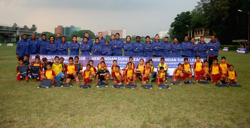 Grassroots Development Officers of Hero Indian Super League Clubs with children participating in the workshop  at Bidhannagar Municipal Sports Complex in Kolkata on Aug 17, 2014.