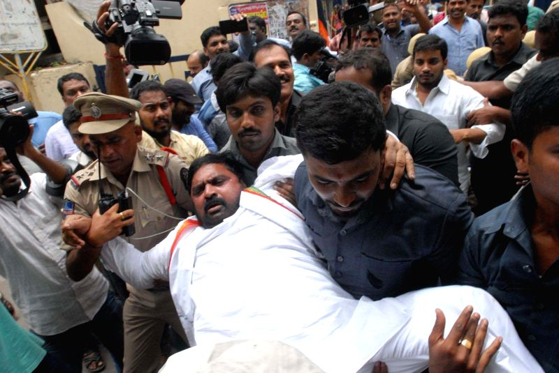 Greater Hyderabad Congress president Anjan Kumar Yadav being taken away by police during a demonstration against the state government over increased number of potholes on the city's roads, ... - Anjan Kumar Yadav