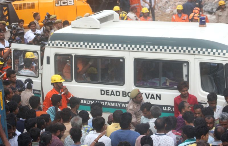 Greater Noida: A hearse carrying bodies of those killed in Greater Noida twin-building collapse being taken away, on July 18, 2018.At least 50 people were believed trapped under the concrete rubble ...