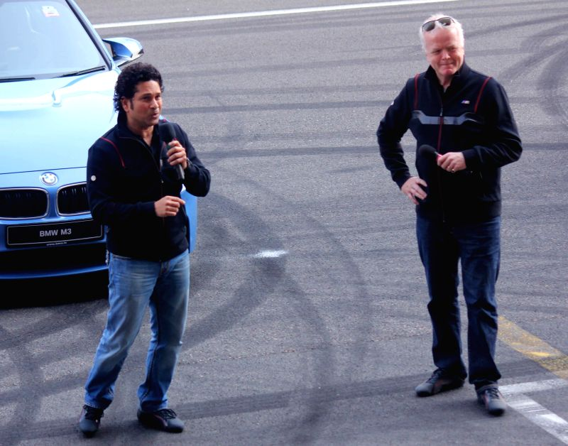 Greater Noida: Cricket legend Sachin Tendulkar with BMW Group India President Philipp von Sahr at the launch of BMW `M3` and `M4` cars at Buddh International Circuit in Greater Noida on Nov 27, 2014. - Sachin Tendulkar