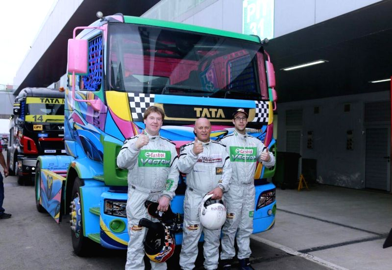 Greater Noida: (L to R) Top three qualifiers, Stuart Oliver from Team Castrol (2nd), Steve Thomas from Team Allied Partners (1st) and Oliver Janes from Team Castrol (3rd) with a new-look Tata PRIMA ...
