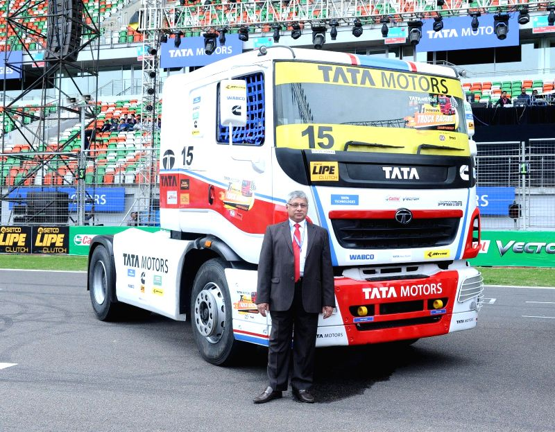 Greater Noida: Tata Motors Ltd Executive Director (Commercial Vehicles Business Unit) Ravindra Pisharody with a new-look Tata PRIMA race truck during inauguration of T1 PRIMA truck racing ...