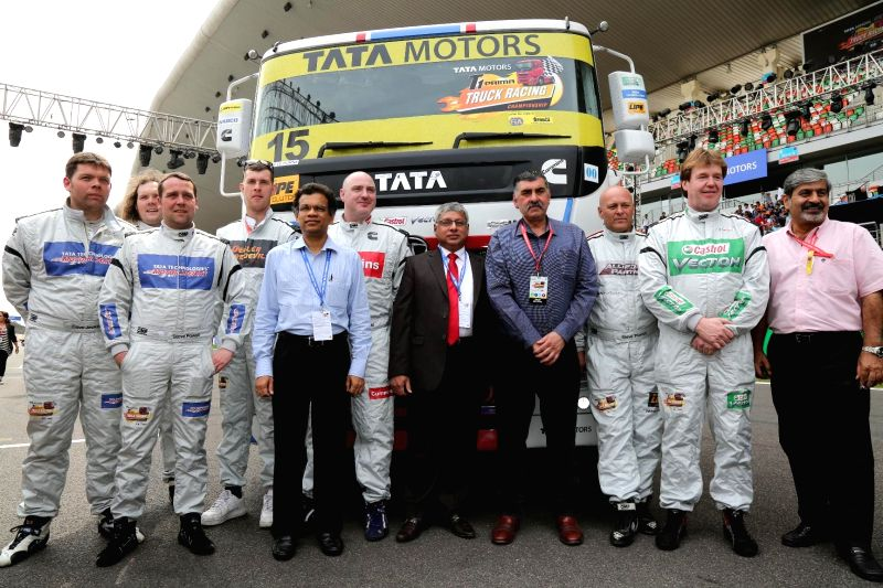 Greater Noida: Tata Motors T1 team and the Drivers with a new-look Tata PRIMA race truck during the inauguration of T1 PRIMA truck racing championship 2015 - Season II at the Buddh International ...