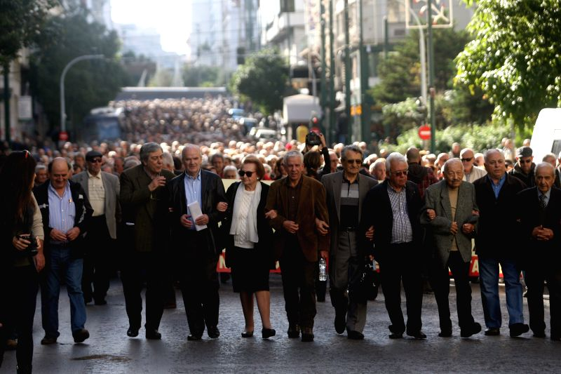 Greek pensioners demonstrate in central Athens against cuts demanded under an international bailout in Athens, capital of Greece, on Nov. 26, 2015. (Xinhua/Marios ...