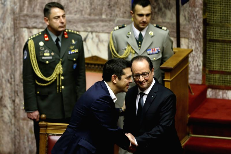 Greek Prime Minister Alexis Tsipras (L, front) shakes hands with French President Francois Hollande (R, front) at the Greek Parliament in Athens, Greece, Oct. 23, ... - Alexis Tsipras