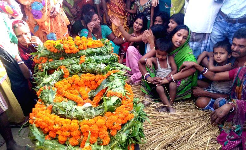 Grief struck family members of Sukma martyr Ranjeet Kumar at his funeral in Sheikhpura of Bihar on April 26, 2017. - Ranjeet Kumar