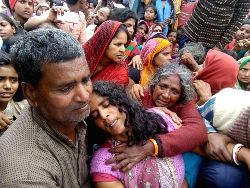 Grief struck relatives of Gunner Kishore Kumar Munna in Bihar's Khagaria district on Feb 13, 2018. Gunner Kishore Kumar Munna had suffered splinter injuries in Pakistani shelling along the ... - Kishore Kumar Munna
