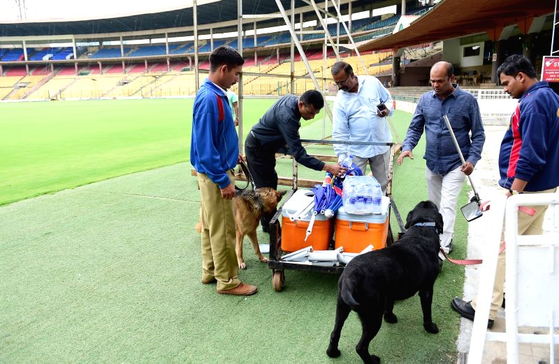 Ground staff ahead of the Indian team's practice session, in Bengaluru on June 11, 2018.