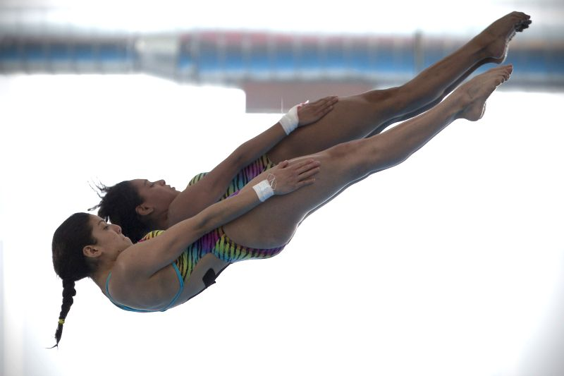 Mexico's Gabriela Agundez and Karla Rivas (FRONT) compete during the women's synchronised 10m platform final at 2015 FINA Diving Grand Prix Leon in the city of ...