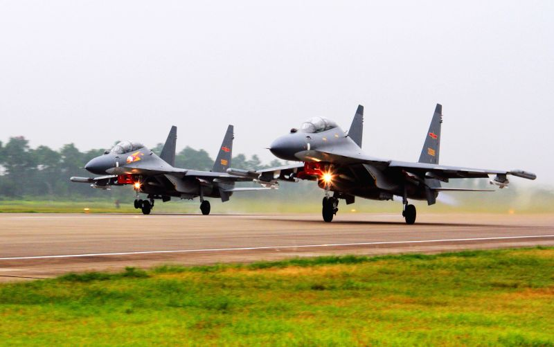 GUANGZHOU, Aug. 6, 2016 - Two Su-30 fighters take off to partol over the South China Sea. Chinese Air Force aircraft, including H-6K bombers and Su-30 fighters, have completed a patrol of airspace ...