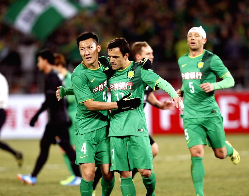 Batalla (C) of China's Beijing Guoan FC celebrates his goal during the AFC Champions League football match against Thailand's Bangkok Glass FC in Beijing, Feb. ...