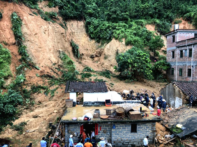 GUANGZHOU, June 8, 2018 - Rescuers work at the landslide scene in Taiping Town, Yunfu City of south China's Guangdong Province, June 8, 2018. Five people have been killed in landslides triggered by ...