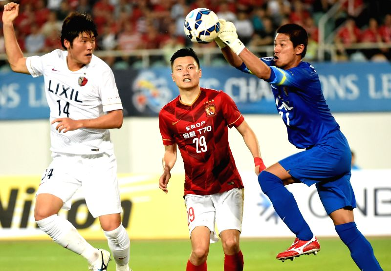 Hitoshi Sogahata (R), goalkeeper of Japan's Kashima Antlers, saves the ball during the group H match against China's Guangzhou EverGrande at the 2015 AFC ...