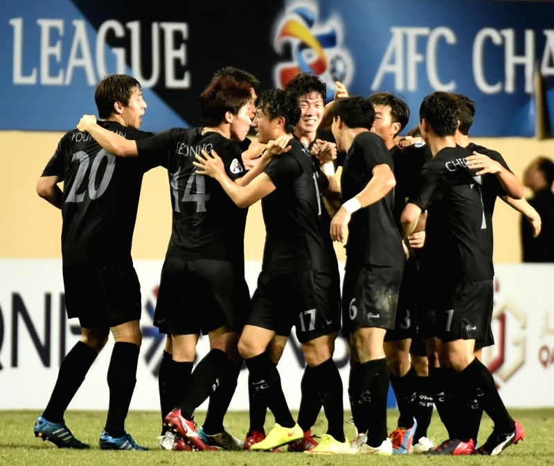 Players of South Korea's Seongnam FC celebrate for a goal during the group F match against China's Guangzhou R&F at the 2015 AFC Champions League in ...