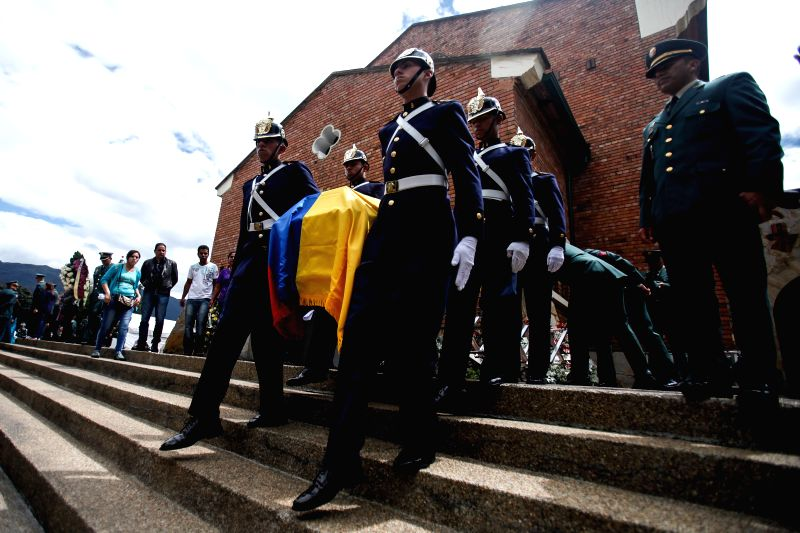 Guards of honor transfer one of the coffins of the soldiers killed by the National Liberation Army (ELN) during a funeral in Bogota, capital of Colombia, Oct. 29, ...