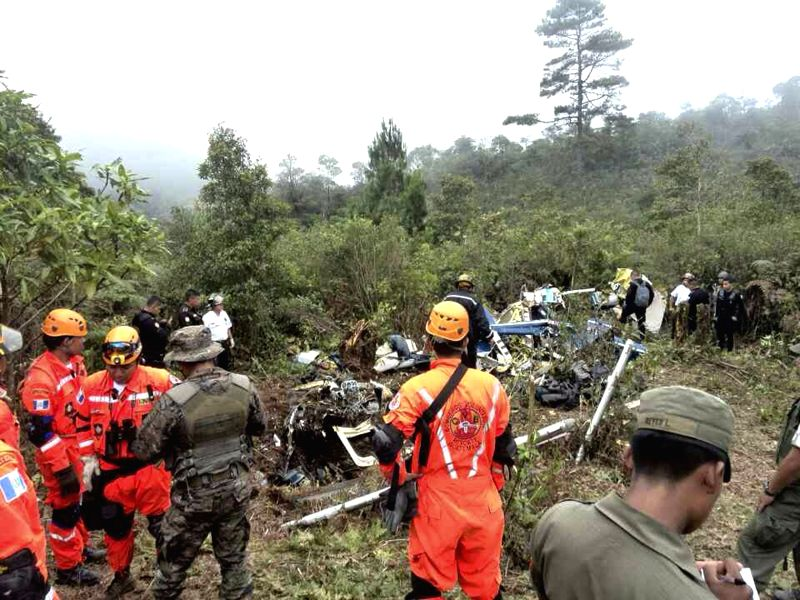 Image provided by the Meritorious Volunteer Fire Department shows the crashed site of an helicopter carrying General Rudy Israel Ortiz, National Defense ...