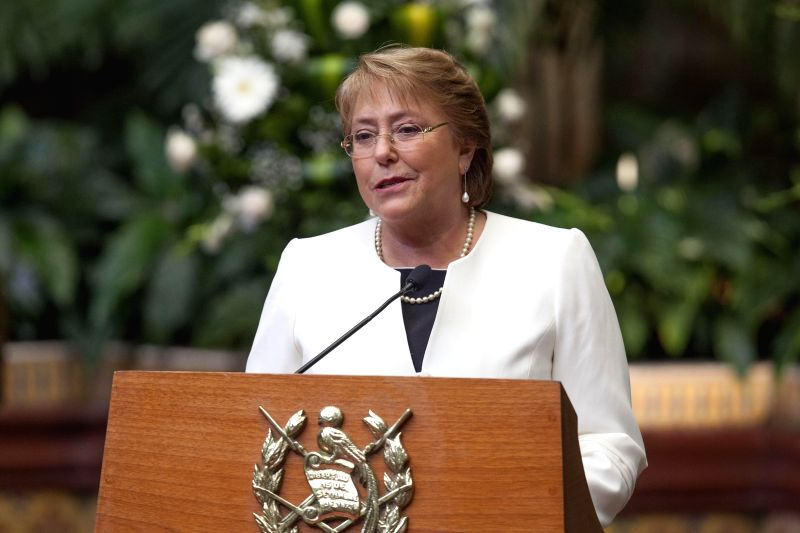 Chile's President Michelle Bachelet delivers a speech during her meeting with Guatemala's President Otto Perez Molina at the National Palace of Culture in ...