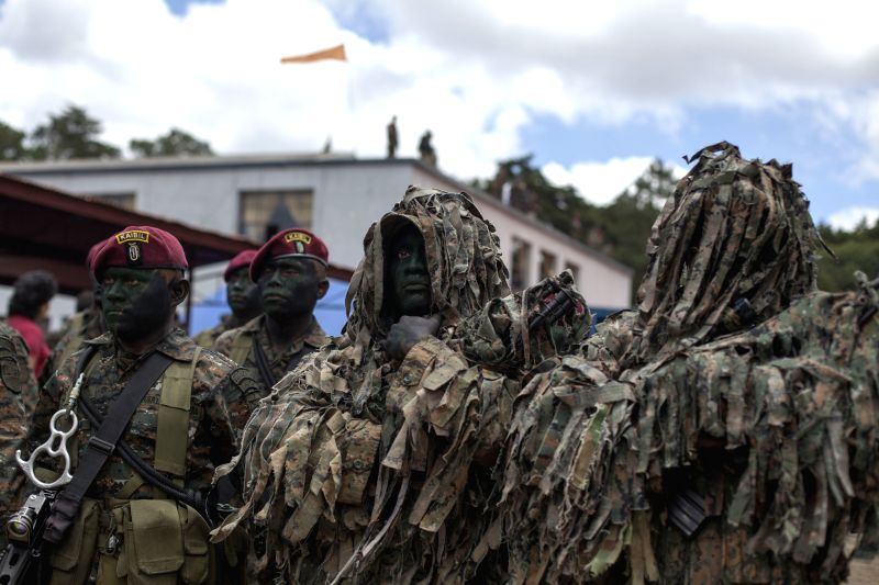 """Soldiers of the elite group """"Kaibil"""" take part in the Parade in commemoration of 143rd anniversary of the Army of Guatemala, in the barracks ..."""
