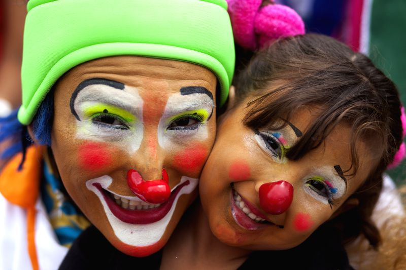 Clowns pose for photos during the sixth Latin American Congress of Clowns parade, at the Historical Center of Guatemala City, capital of Guatemala, on July ..