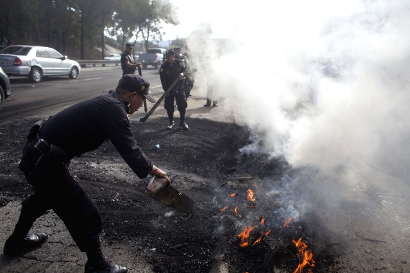 Members of the Guatemalan Civil National Police clear a street during a protest, in Guatemala City, capital of Guatemala, on July 28, 2014. Approximately 150