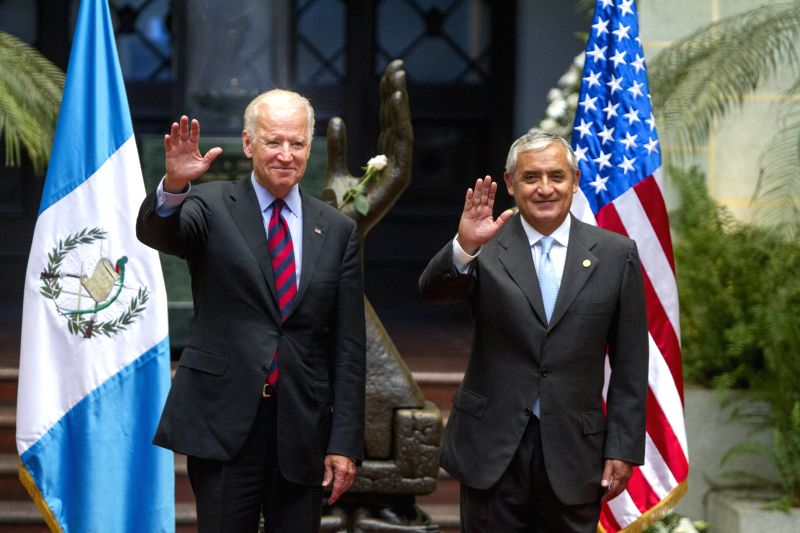 U.S. Vice President Joe Biden (L), and Guatemala's President Otto Perez Molina, wave upon their arrival at the National Palace of Culture, in Guatemala City,