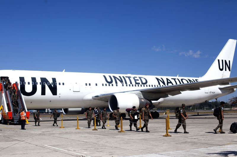 Guatemala Army soldiers descend of a United Nations (UN) plane, at Guatemalan Air Force facilities, in Guatemala City, capital of Guatemala, on March 11, ...