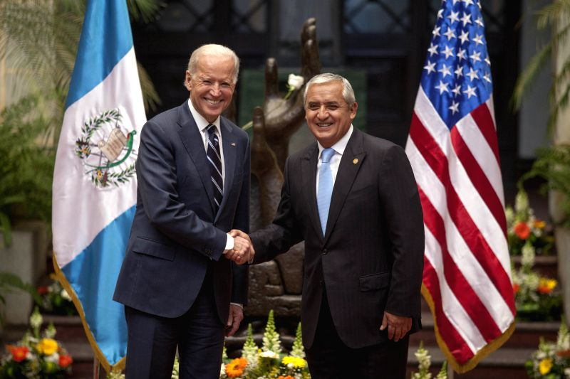 Guatemala's President Otto Perez Molina (R) meets with Vice President of the United States Joe Biden in the National Culture Palace, in Guatemala City, ...