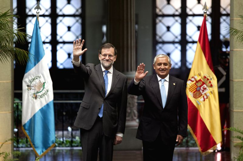 The Guatemalan President Otto Perez Molina (R) meets with Spanish Prime Minister Mariano Rajoy in the National Palace of Culture, in Guatemala City, capital ... - Mariano Rajoy