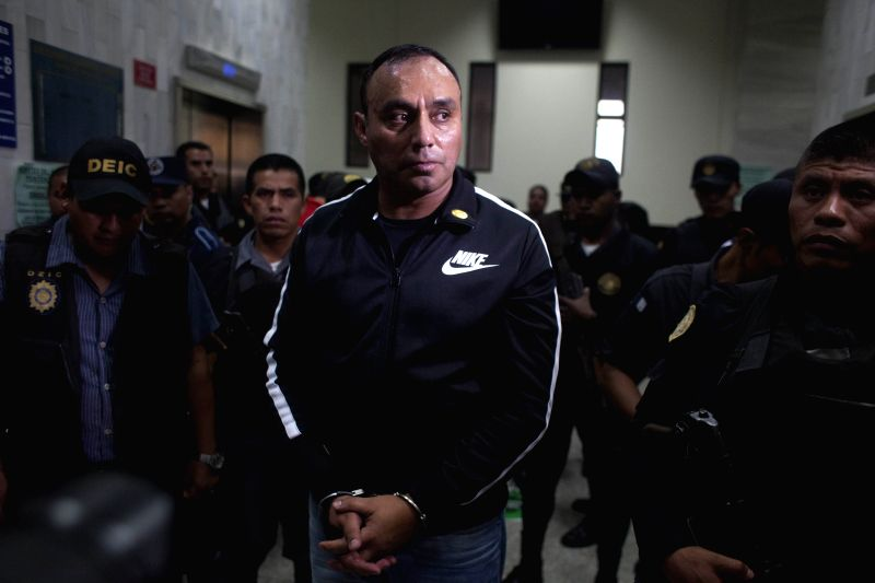 Former Guatemalan Army Captain Byron Lima Oliva (C), sentenced in 2006 to 20 years in prison for the 1998 slaying of Bishop Juan Jose Gerardi, arrives to a ..