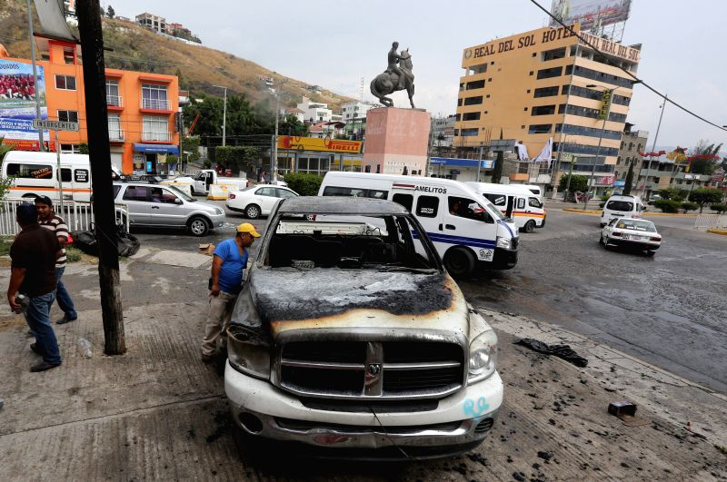 Photo taken on Dec. 14, 2014 shows a damaged vehicle remains after a clash between teachers of the State Coordinator of Education Workers of Guerrero and agents of