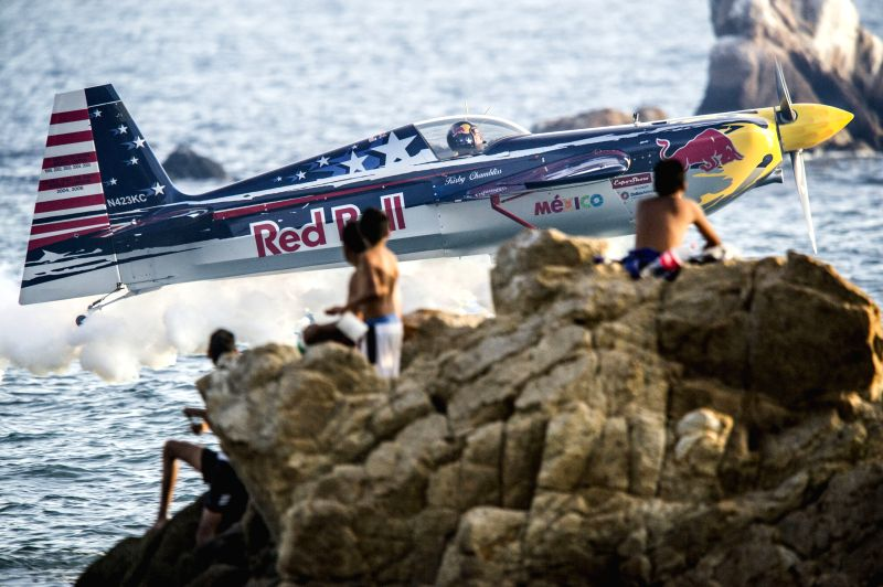 A plane makes a practice flight ahead of 2014 Acapulco Air Show, at Santa Lucia bay, in Acapulco municipalty, of Guerrero State, Mexico, on Dec. 26, 2014. The ...