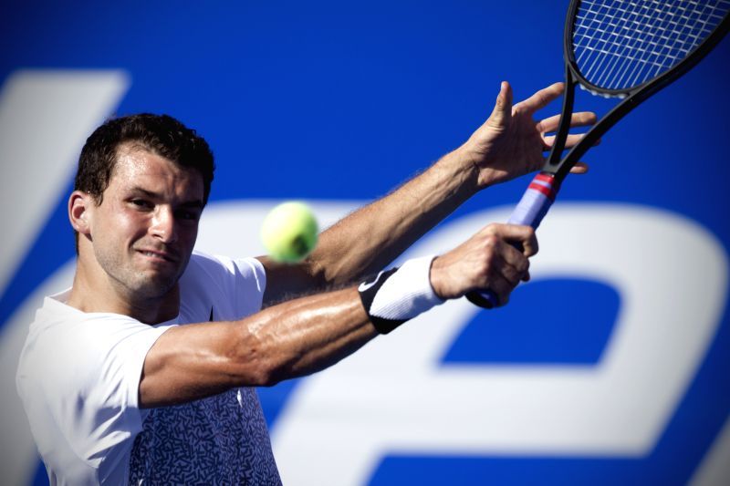 Bulgaria's Grigor Dimitrov returns the ball during the men's single match of the Mexican Tennis Open 2015 against Serbia's Filip Krajinovic in Acapulco, Guerrero ...