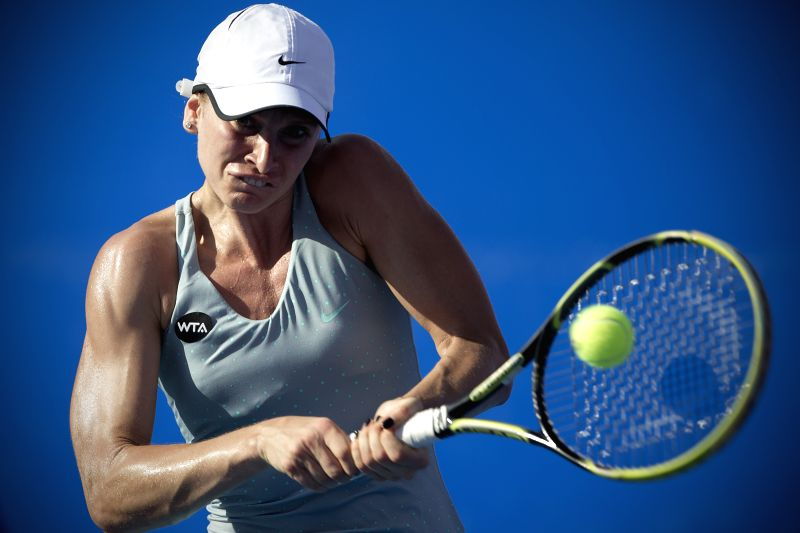 Bulgaria's Sesil Karatantcheva hits a return to Switzerland's Timea Bacsinszky during the women's single semifinal match of the Mexican Tennis Open 2015 torunament ...