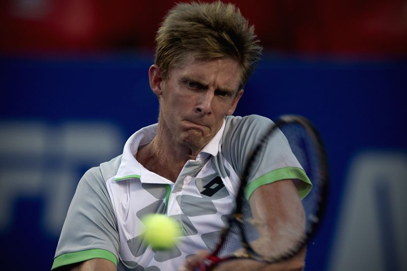 South Africa's Kevin Anderson hits a return to Japan's Kei Nishikori during the men's single semifinal match of the Mexican Tennis Open 2015 torunament in ...