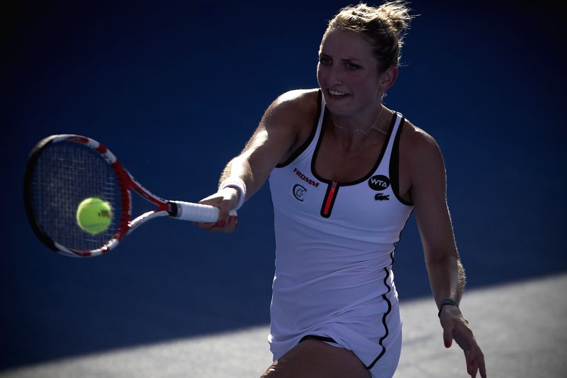 Switzerland's Timea Bacsinszky hits a return to Bulgaria's Sesil Karatantcheva during the women's single semifinal match of the Mexican Tennis Open 2015 torunament ...