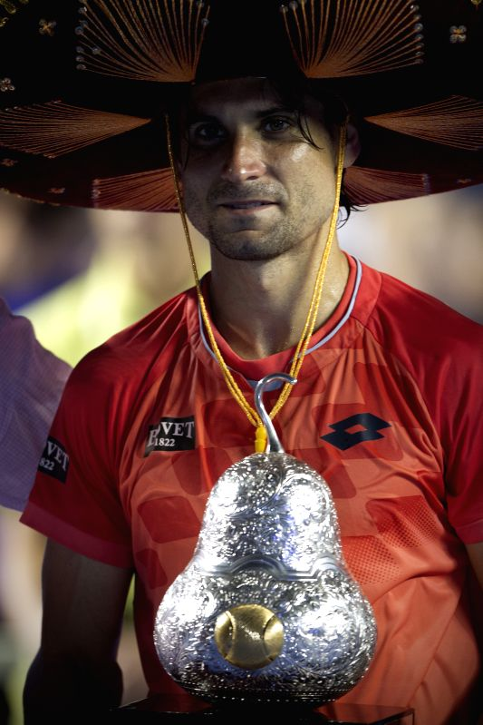 Spain's David Ferrer poses with the trophy after winning the men's singles final against Japan's Kei Nishikori on the Mexican Tennis Open 2015 tournament in ...
