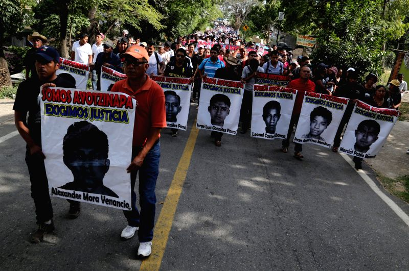 Residents take part in a march for the missing students of the Normal Rural School of Ayotzinapa in Iguala, in Tecoanapa of Guerrero, Mexico, on Dec. 11, 2014.