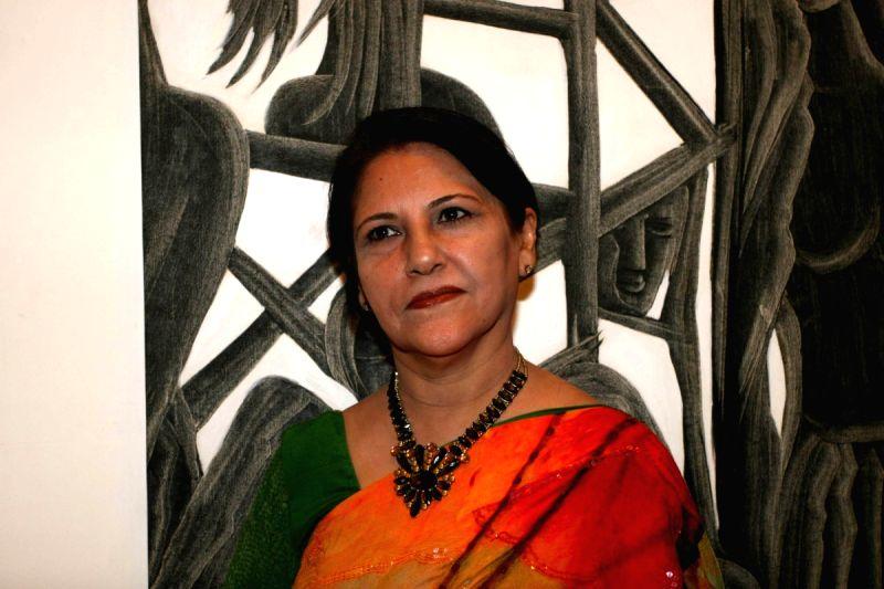 Guest at grace poet and artist Kiran Chopra's exhibition at Jehangir Art Gallery. - Kiran Chopras