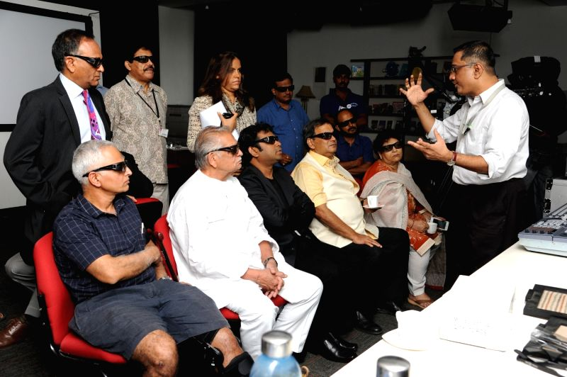 Guests wearing 3D glasses at the Sony Media Technology Centre at Whistling Woods International.