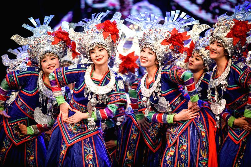 """Dancers perform during a musical drama """"Colorful Guizhou"""" in Guiyang, capital of southwest China's Guizhou Province, April 2, 2015. (Xinhua/Liu Xu) ..."""