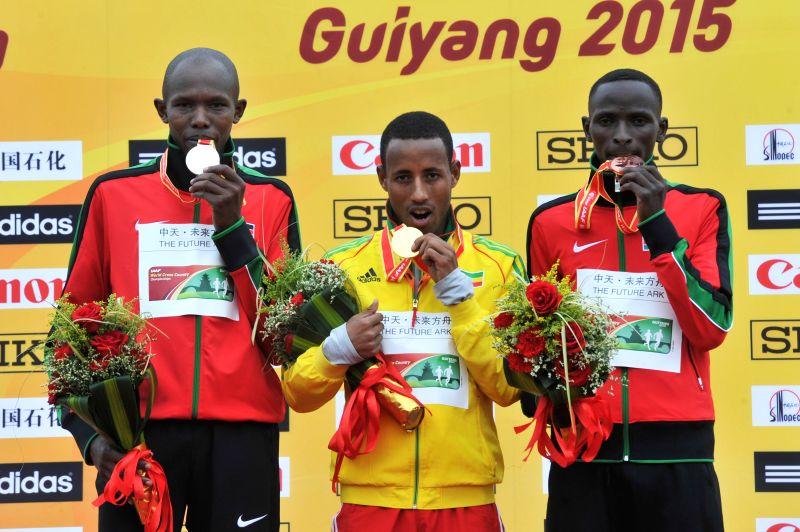 Gold medalist Yasin Haji (C) of Ethiopia, silver medalist Geoffery Kipkirui Korir (L) of Kenya and bronze medalist Alfred Ngeno of Kenya pose on the podium during ...