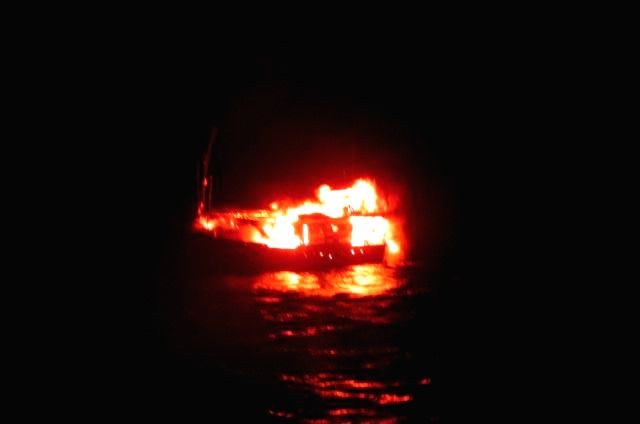 A fishing boat laden with explosives from Pakistan which was intercepted by Indian Coast Gurad, set on fire by crew near Porbander coast in Gujarat.